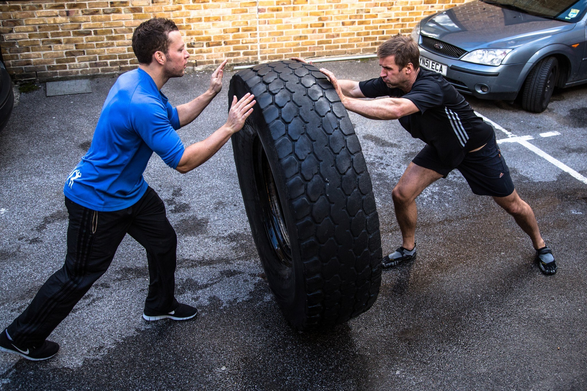 Personal trainer in London doing the tire flip