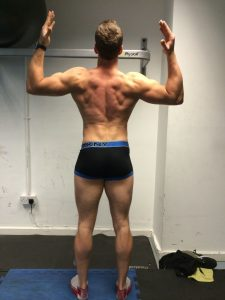 Cheeky back pose 7 weeks into my London body transformation